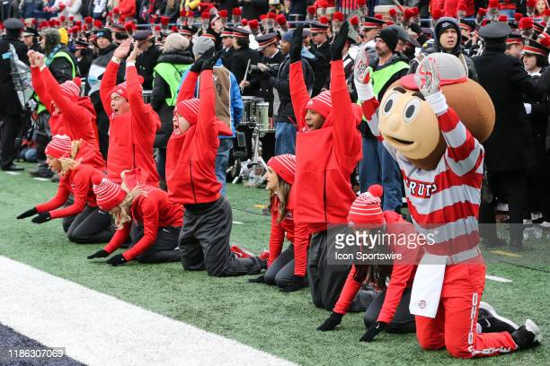 Ohio State cheerleaders and mascot Brutus celebrate a score during a regular season Big 10 Conference game between the Ohio State Buckeyes and the...