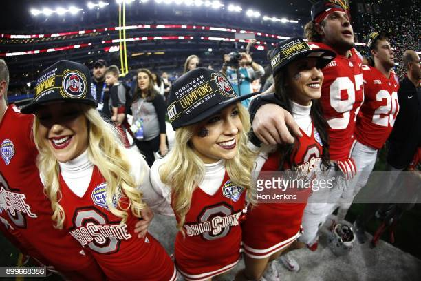 Ohio State cheerleaders and players celebrate following the 82nd Goodyear Cotton Bowl Classic between USC and Ohio State at ATT Stadium on December...