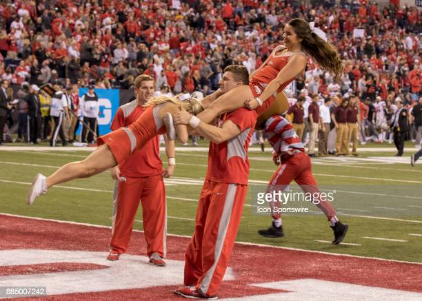 Ohio State cheerleaders performing a stunt during a TV time out during the Big 10 Championship Game between the Ohio State Buckeyes and the Wisconsin...