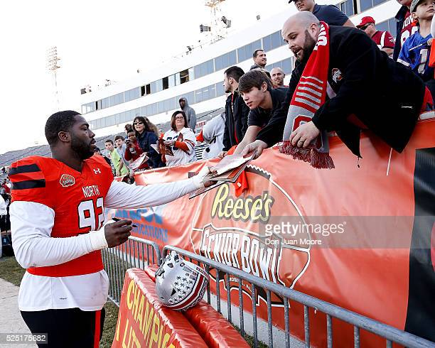 Ohio State Defensive Tackle Adolphus Washington of the North Team signs a few things for fans after the 2016 Resse's Senior Bowl at LaddPeebles...