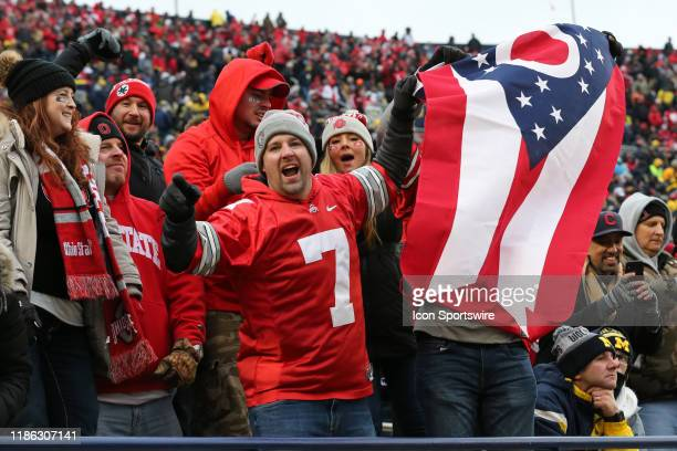 Ohio State fans celebrate during a regular season Big 10 Conference game between the Ohio State Buckeyes and the Michigan Wolverines on November 30...