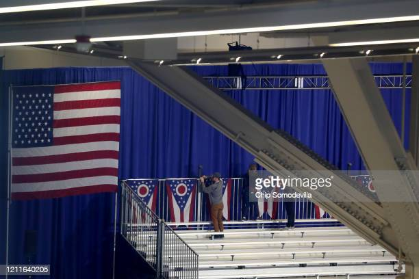 Ohio state flags are taken down inside the Huntington Convention Center after Democratic presidential candidate Sen Bernie Sanders canceled his...