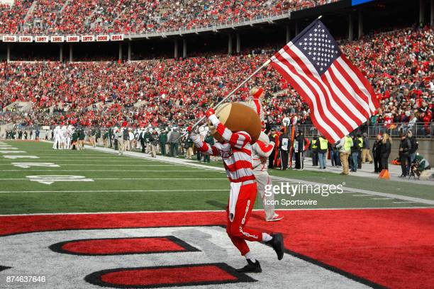 Ohio State mascot Brutus Buckeye waves an American flag before the start of the game between the Michigan State Spartans and the Ohio State Buckeyes...