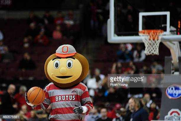 Ohio State Mascot Brutus the Buckeye goofs around with a basketball prior to the start of the game against the Nebraska Cornhuskers on January 4...