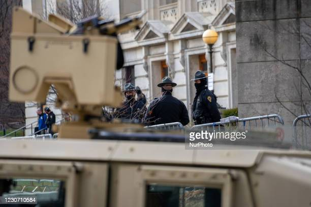 Ohio State Patrol Troopers perform security as members of Antifa march from City Hall to the Ohio Statehouse after President Joe Biden was sworn into...