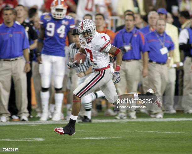 Ohio State punt returner Ted Ginn Jr returns the opening kickoff for a touchdown against Florida in the Tostitios BCS National Championship Game at...
