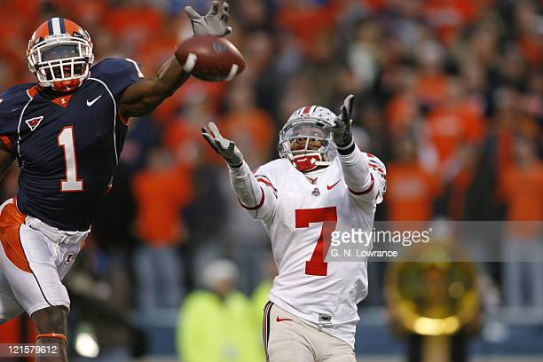 Ohio State receiver Ted Ginn Jr attempts to make a catch as Vontae Davis defends during action between the Ohio State Buckeyes and Illinois Fighting...