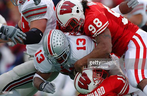 Ohio State tailback Maurice Clarett is brought down by tackle Darius Jones and safety Jim Leonhard of Wisconsin in the fourth quarter of the NCAA...