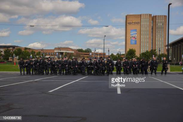Ohio State Troopers mass up in a parking lot across from the Kent State University before the Open Carry Rally Kaitlin Bennett a former student of...