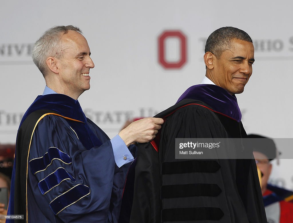 Ohio State Trustee David Horn (L) puts a sash on U.S. President Barack Obama during commencement ceremonies at The Ohio State University at Ohio Stadium on May 5, 2013 in Columbus, Ohio. Obama addressed the graduates a year from the day he kicked off his re-election campaign at the campus.The president was also given an honorary degree Doctor of Laws.