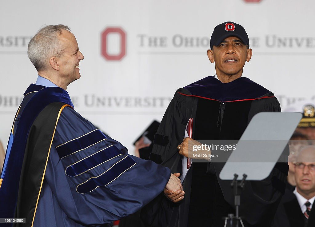 Ohio State Trustee David Horn (L) shakes hands with U.S. President Barack Obama during commencement ceremonies at The Ohio State University at Ohio Stadium on May 5, 2013 in Columbus, Ohio. Obama addressed the graduates a year from the day he kicked off his re-election campaign at the campus.The president was also given an honorary degree Doctor of Laws.