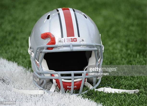 Ohio State University football helmet sits on the sideline before a game with the Ohio State Buckeyes at Michigan Stadium in Ann Arbor Michigan The...