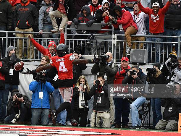 Ohio State University halfback Curtis Samuel celebrates in the end zone after scoring the gamewinning touchdown against the Michigan Wolverines in...