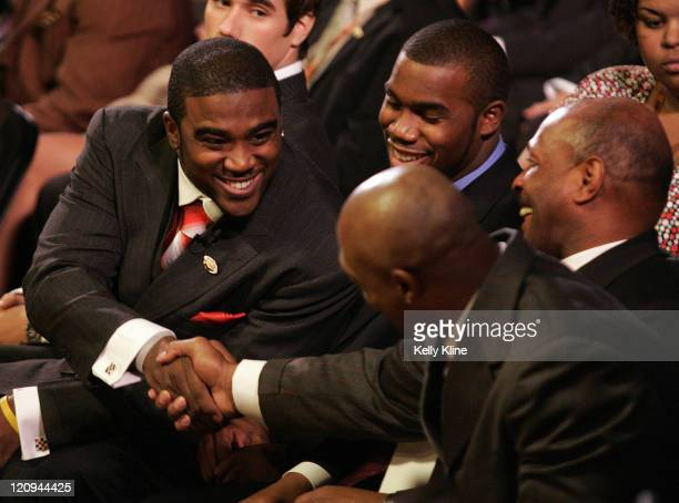 Ohio State University quarterback Troy Smith shakes hands with an Eddie George, 1995 Heisman Trophy winner from Ohio State, at the start of the...