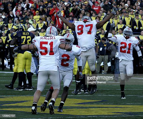 Ohio State University's David Patterson along with Anthony Schlegel Malcolm Jenkins and Nate Salley celebrate their victory over University of...
