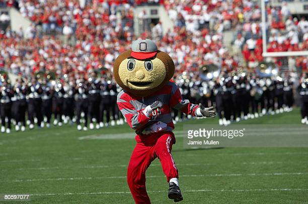 Ohio State's Brutus Buckeye heads out onto the field in front of the OSU marching band before the game against Marshall University September 11 in...