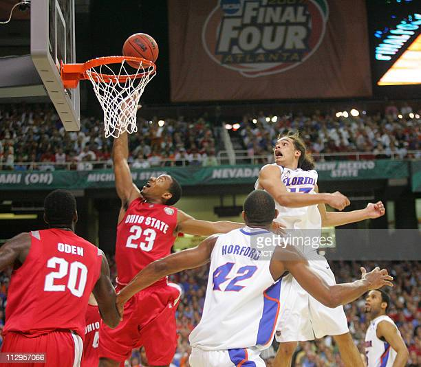 Ohio State's David Lighty drives past Florida's Joakim Noah during the first half of the NCAA Men's Basketball Championship game at the Georgia Dome...