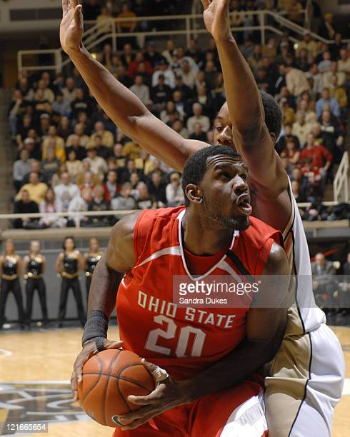 Ohio State's Greg Oden ducks under the arms of Carl Landry as he moves to score in the game won by Ohio State 7860 in Mackey Arena in West Lafayette...