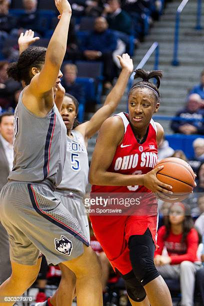 Ohio State's Guard Kelsey Mitchell works around UConn Huskies Guard Gabby Williams during the second half a women's NCAA division 1 basketball game...