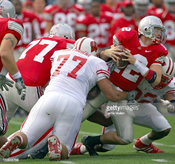 Ohio State's Justin Zwick is sacked by Wisconsin's Anttaj Hawthorne early in the first quarter of their game against the Wisconsin Badgers Saturday...