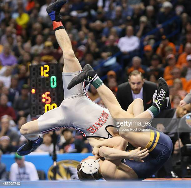 Ohio State's Nathan Tomasello left wrestles with West Virginia's Zeke Moisey in the 125pound championship match during the NCAA Division I Wrestling...