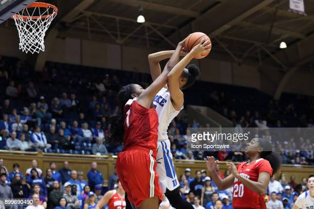 Ohio State's Stephanie Mavunga blocks a shot by Duke's Leaonna Odom during the Duke Blue Devils game versus the Ohio State Buckeyes on November 30 at...