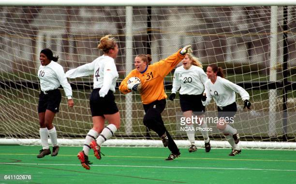 Ohio Wesleyan University goalie Mindy Hammond and her teammates celebrate their victory over Messiah College during the Division III Women's Soccer...