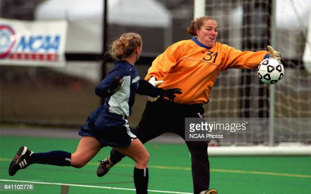 Ohio Wesleyan University goalie Mindy Hammond gobbles up a shot by Messiah College's Erin Benedict during the Division III Women's Soccer...