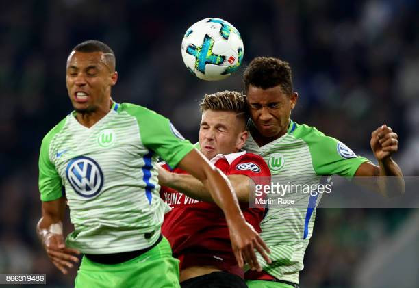 Ohis Felix Uduokhai of Wolfsburg and Niclas Fuellkrug of Hannover battle for the ball during the DFB Cup match between VfL Wolfsburg and Hannover 96...