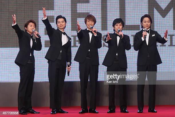 Ohno Satoshi, Matsumoto Jun, Aiba Masaki, Ninomiya Kazunari and Sakurai Sho of Arashi arrive at the opening ceremony during the 27th Tokyo...