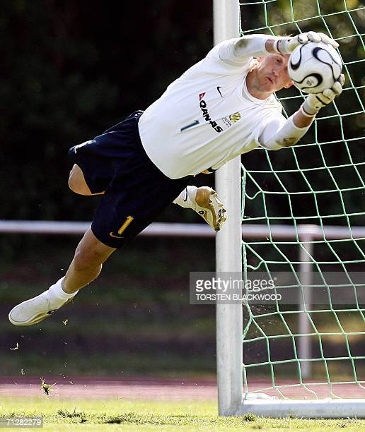 Australian goalkeeper Mark Schwarzer dives to catch a ball during a Socceroos' training session in Ohringen, 23 June 2006. The Socceroos will play...