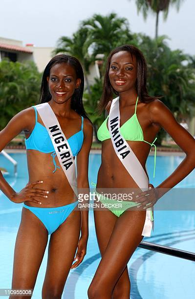 Ohumotu Bissong Miss Nigeria 2003 and Ndapewa Alfons Miss Namibia 2003 pose in swimwear during registration and fittings at the Hotel El Panama in...