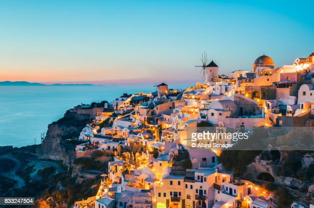 oia santorini greece at dusk - greek flag stock pictures, royalty-free photos & images