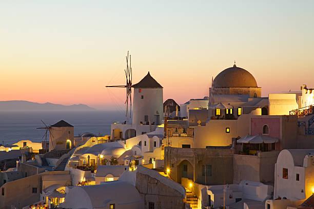 Oia village cityscape at sunset. Santorini. Greece.