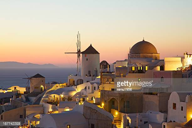 oia village cityscape at sunset. santorini. greece. - caldera stock pictures, royalty-free photos & images