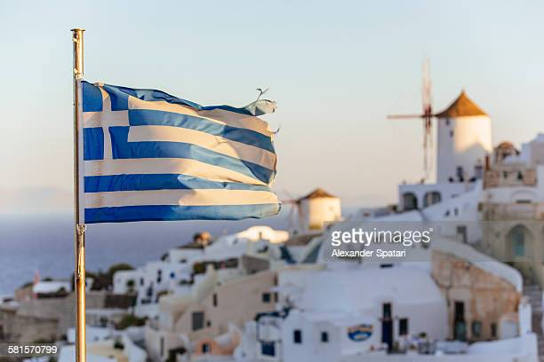 oia village in santorini and flag of greece - greek flag stock pictures, royalty-free photos & images