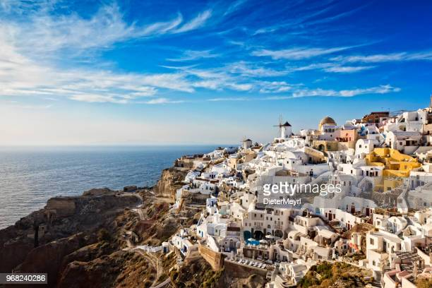 oia village in santorini island with famous churches, greece - greece stock pictures, royalty-free photos & images