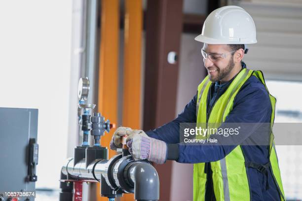 Oil and Gas engineer working on pipeline equipment at job site