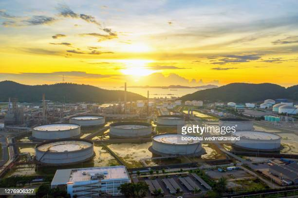 oil and gas industry - refinery at sunset - factory - petrochemi - greenpeace stock pictures, royalty-free photos & images