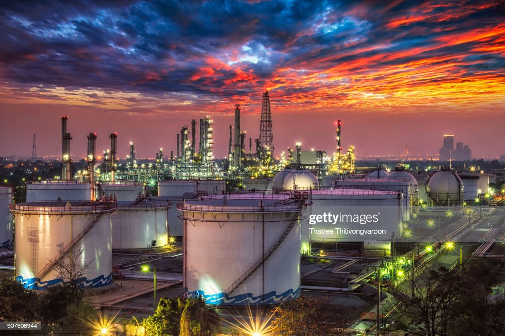 Oil and gas industry - refinery at sunset - factory - petrochemical plant : Stock Photo