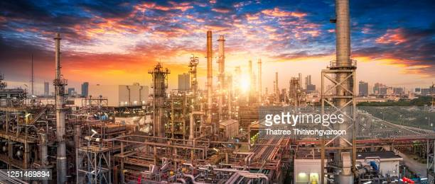 oil and gas industry - refinery factory - petrochemical plant at sunset - greenpeace stock pictures, royalty-free photos & images
