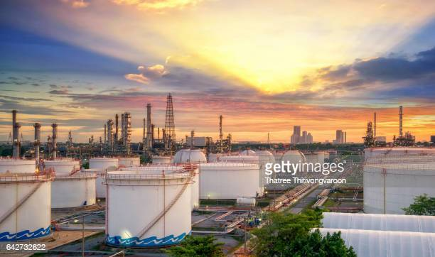 oil and gas industry - refinery factory - petrochemical plant at sunset - storage tank stock photos and pictures