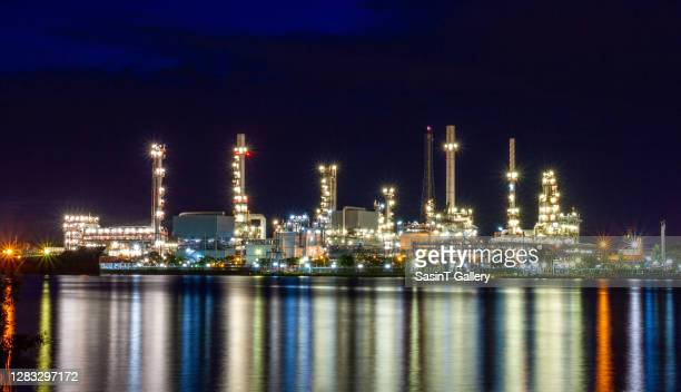 oil and gas industry - refinery - greenpeace stock pictures, royalty-free photos & images