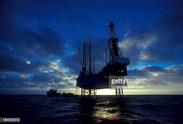 Oil and gas Jackup drilling rig at sunset in the Gulf of Mexico