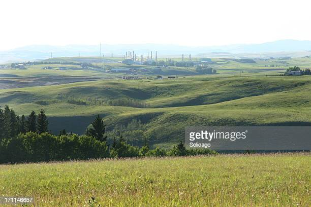 oil and gas  plant with farmland - foothills stock pictures, royalty-free photos & images