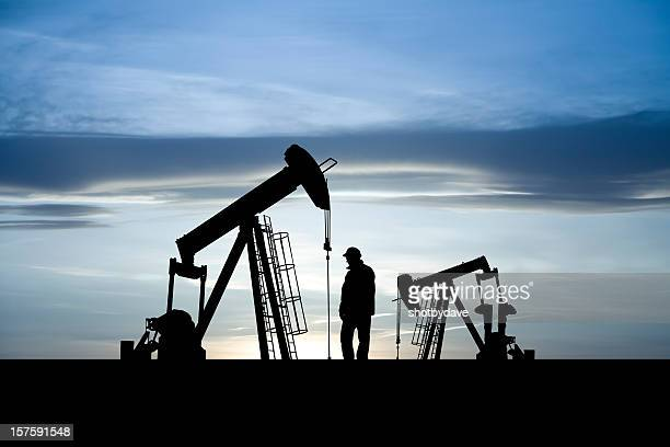 oil and gas pumpjacks - oil prices stock pictures, royalty-free photos & images