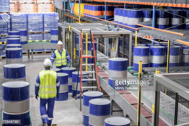 Oil barrels in robotic storage in oil blending factory