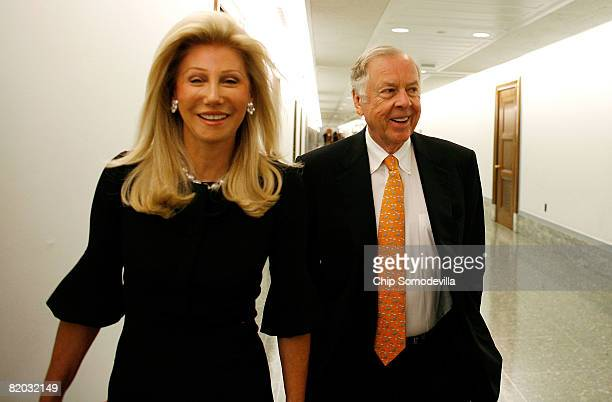 Oil billionaire T. Boone Pickens and his wife Madeleine Pickens arrive at the Dirksen Senate Office Building ahead of testifiying before the Senate...