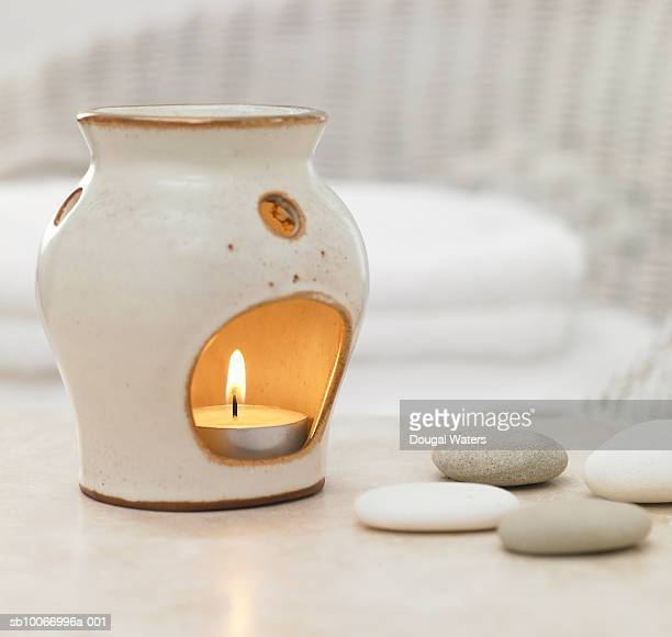 Oil burner with lit candle