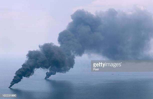 Oil burns and creates plumes of smoke near the site of the Deepwater Horizon oil spill on June 19 2010 in the Gulf of Mexico off the coast of...
